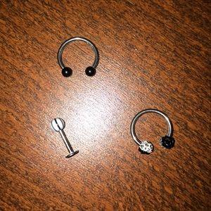 Helix ( cartilage ) earrings .